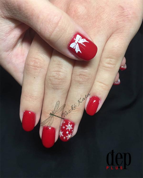 Gợi ý những mẫu nails đỏ rực rỡ ngày Tết