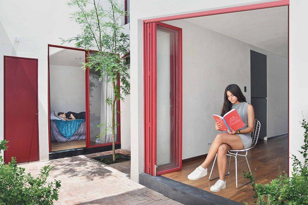 Không gian sống đẹp 'lộng lẫy' cải tạo từ ba ngôi nhà cũ - 9